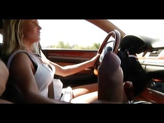 MILF gives handjob in the long run b for a long time driving